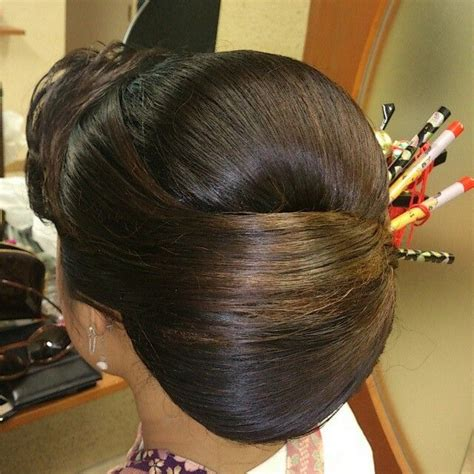 pin  parita suchdev  western  bun hairstyles hair