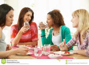 A Group of Women Sitting at Table Eating
