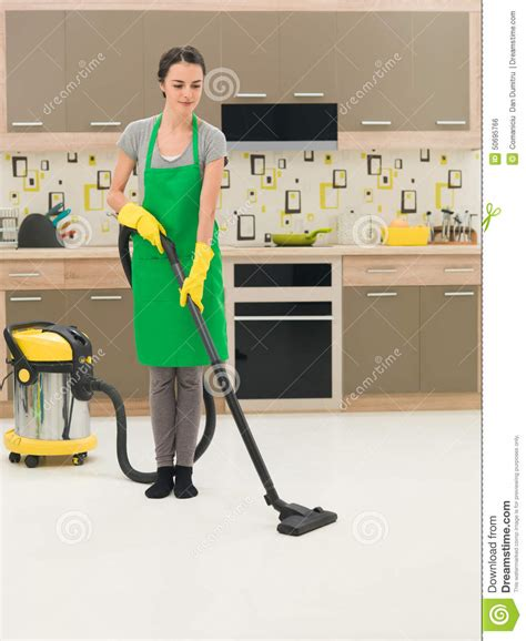 vacuuming floors woman vacuuming kitchen floor stock photo image 50695766