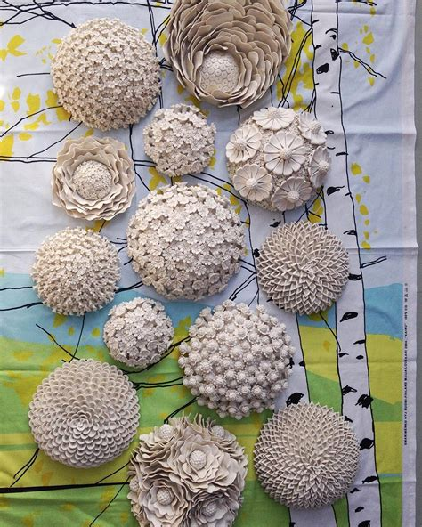 ornate ceramic vessels encased  porcelain flowers