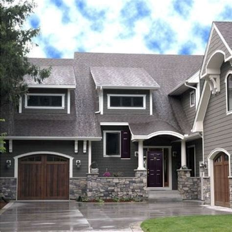 exterior house colors grey house with white trim wooden looking garage door and a