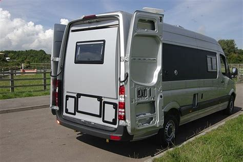 ... New Motorhome With Slide-out Rear Section To Sleep 4