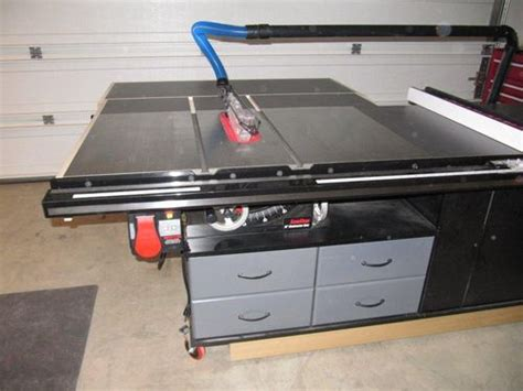 sawstop cabinet saw outfeed table my sawstop and router cabinet with fold outfeed table