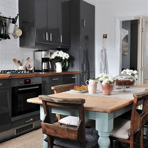 grey gloss kitchen  rustic table decorating