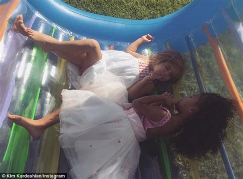 kim kardashian shares snap of penelope playing with north daily mail online