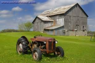 Old Barn and Tractor in a Field