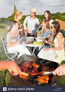 young people having barbecue Stock Photo - Alamy