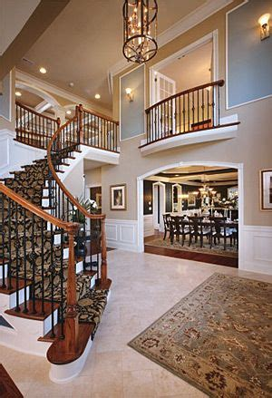 beautiful entry  curved staircase house design