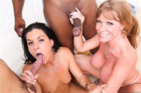 Two Busty Milfs Enjoying Some Interracial Group Sex