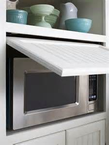 Hide Microwave In Cabinet by Beadboard Cabinets Cottage Kitchen Bhg