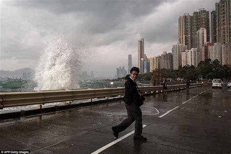 typhoon haima warning   hong kong locals  takes selfies  storm daily mail