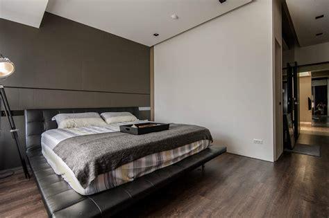 masculine bed frames stone and wood make a dark masculine interior