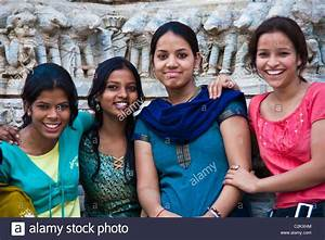 Four Indian girls having fun at a temple Stock Photo ...