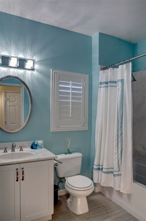 I Love The Color Of The Teal Wall Paint In This Bathroom
