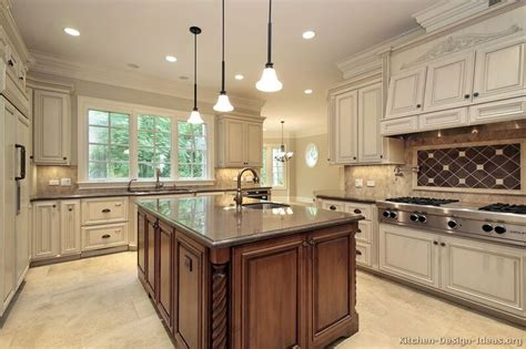 light cabinets with island and granite counter