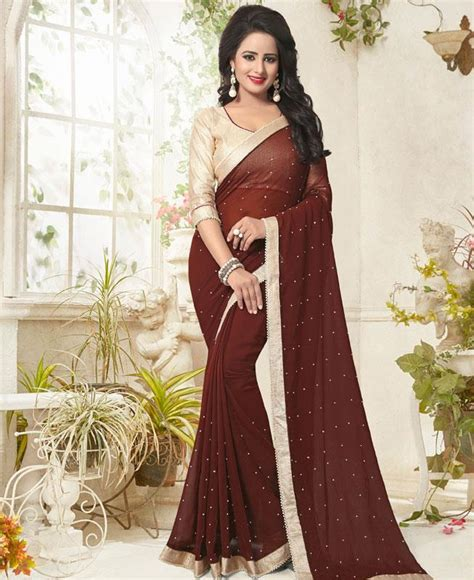 This silk blouse has beautifully crafted heavy intricate stone work and kundan. Buy Well Formed Coffee Brown Casual Saree 104473 at $27.52