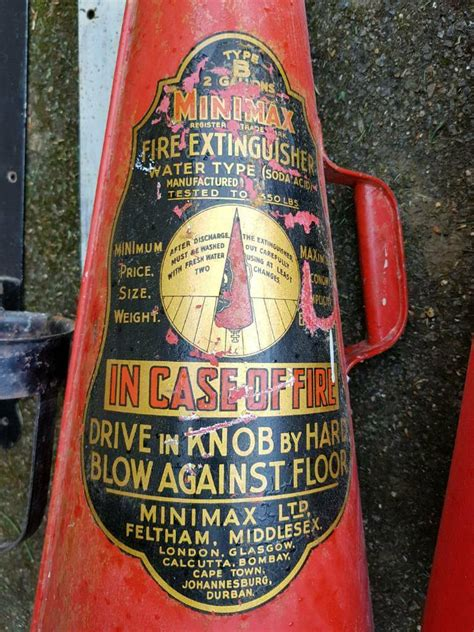 vintage mini max fire extinguishers  wall brackets