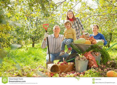 Happy Family With Harvest In Garden Stock Image  Image Of