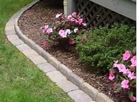 flower bed edging Edging a Flower Bed With Cement Pavers - InfoBarrel