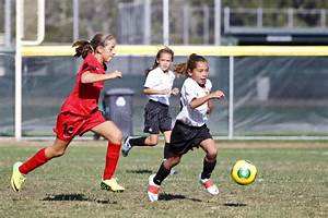 Girls Youth Soccer Football Players Running For The Ball ...