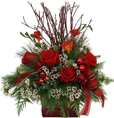 25 best ideas about christmas floral arrangements on pinterest christmas arrangements