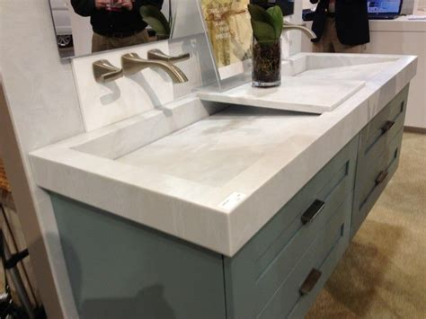 sloping white trough sink   wall faucets bathroom