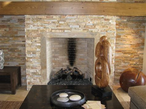 Fireplace In Stone Wall Under Artistic Painting Space