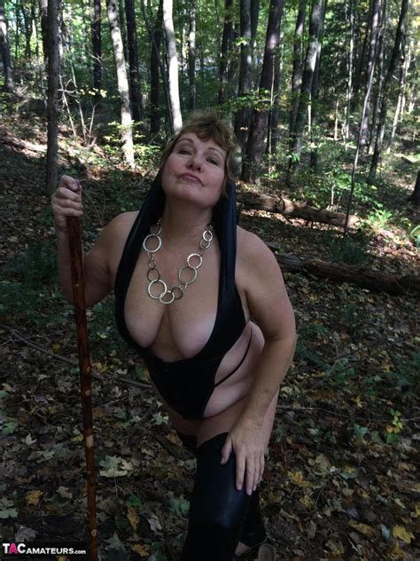 busty bliss latex riding wood outside pt1 pictures