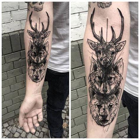 blackwork style medium size forearm tattoo