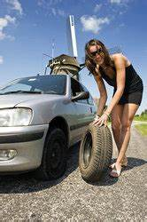 How To Make Email Templates Beautiful Woman Fixing Flat Tire Stock Photo