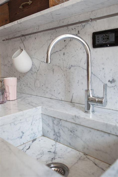 intimate  cozy kitchens  carrara marble house