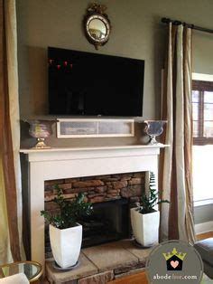 tv above fireplace where to put components where to put cable box with tv fireplace for
