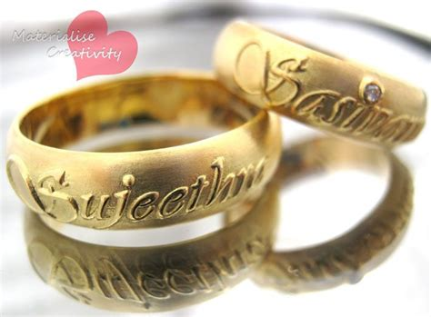 gold engagement rings materialise creativity 18k yellow gold name embossed engagement rings