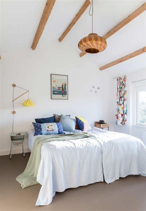 white interior filled  mid century modern