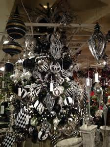 black and white christmas tree with silver and black white baubles connected by black pendant
