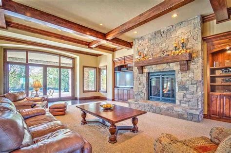 craftsman living room  stone fireplace built  bookshelf hardwood floors eldorado stone
