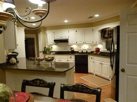 remodel complete, tropic brown granite, Dover White