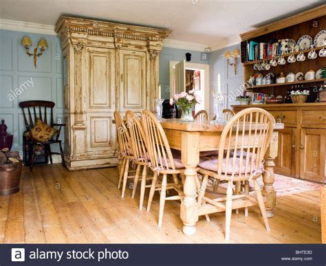 Wheelback Chairs And Pine Table In Country Dining Room