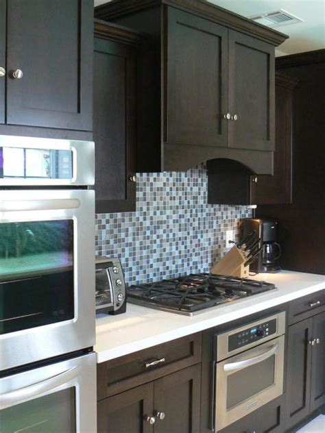 contemporary kitchen  rich brown cabinetry  mosaic