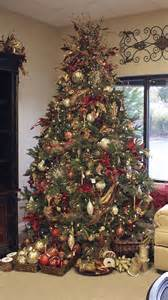 tree with baskets of ornaments i like the idea of the baskets underneath the tree or
