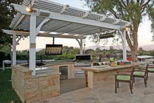 trellis surrounded by knee wall and counter top outdoor