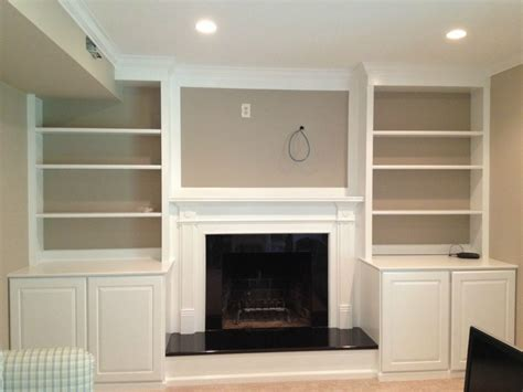 built in place mki custom trimwork and painting fireplace mantels built in cabinets