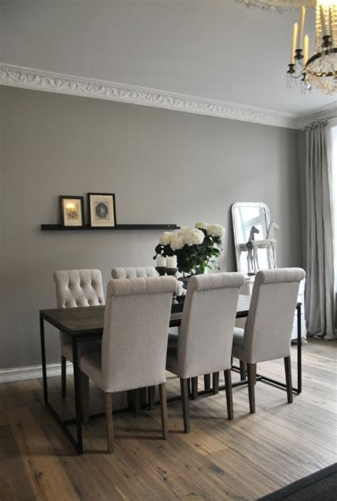 gray walls and beautiful crown moulding from vintage chic leilighet dining rooms