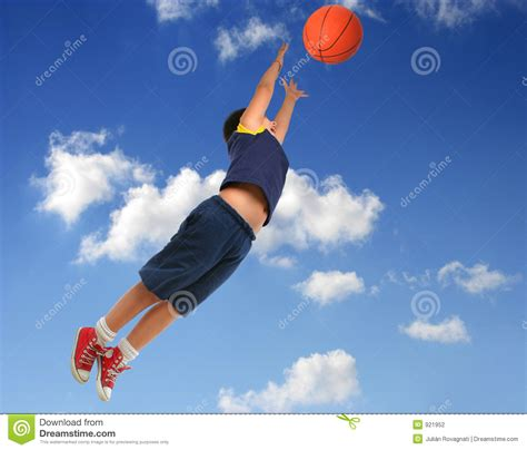 children s basketball hoops boy basketball flying with blue sky stock