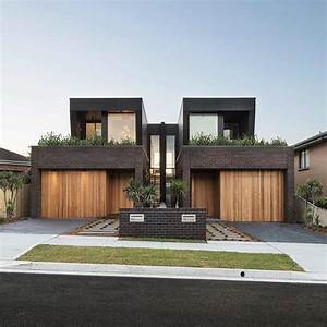 With A Sleek Mixture Of Brick Cladding Timber And Glass