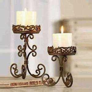 17 best images about candles and candle holders on for What kind of paint to use on kitchen cabinets for wrought iron candle holders for fireplace