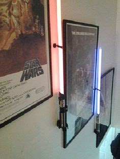 thinkgeek vertical wall mount for stars wars force fx lightsabers dill meets the lightsaber
