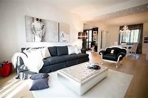 Sofisticato progetto con arredamento elegante Contemporaneo Soggiorno Milano di