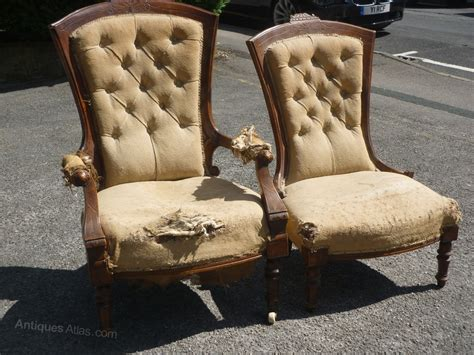 a pair grandfather grandmother chairs