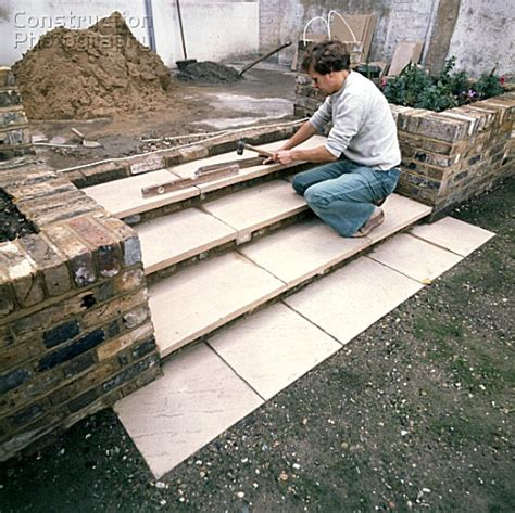 patio laying patio slabs